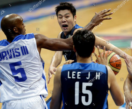 Cho Sung-min, Lee Jung-hyun, Quincy Davis III South Korea's Cho Sung-min, center, passes the ball to teammate Lee Jung-hyun (15) as Taiwan's Quincy Davis III, defends during the bronze match of the FIBA Asia Basketball Championship at the Mall of Asia Arena at suburban Pasay city, south of Manila, Philippines
