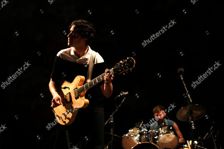 Stock Image of Ezra Koening, Chirs Tomson Vocal and guitarist Ezra Koening and drummer Chris Tomson, of the U.S. band Vampire Weekend perform during their concert at the Optimus Alive music festival in Lisbon