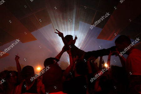 """People dance during a concert by Australian musician Harley Streten """"Flume"""" at the Optimus Alive music festival in Lisbon, Portugal"""