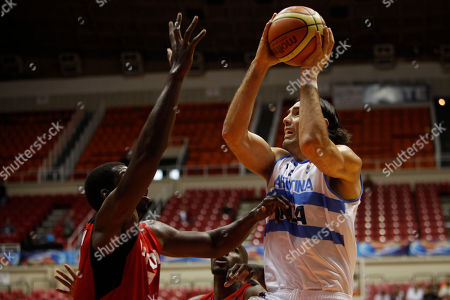 Luis Scola, Joel Anthony Argentina's Luis Scola, right, goes up for a shot against Canada's Joel Anthony during a Tuto Marchand Cup basketball game in San Juan, Puerto Rico