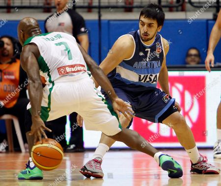 Larry Taylor, Facundo Campazzo Brazil's Larry Taylor, left, dribbles the ball around Argentina's Facundo Campazzo during their Tuto Marchand Cup basketball game in San Juan, Puerto Rico