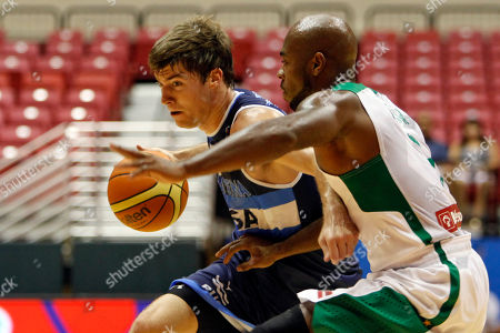 Larry Taylor, Juan Fernandez Brazil's Larry Taylor, right, pressures Argentina's Juan Fernandez during their Tuto Marchand Cup basketball game in San Juan, Puerto Rico