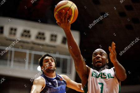 Larry Taylor, Facundo Campazzo Brazil's Larry Taylor, right, goes up for a shot against Argentina's Facundo Campazzo during their Tuto Marchand Cup basketball game in San Juan, Puerto Rico