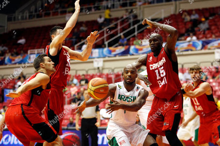 Larry Taylor, Levon Kendall, Joel Anthony, Andrew Routins Brazil's Larry Taylor, center, make a pass under pressure of Canada's Levon Kendall, left, Joel Anthony, right and Andrew Routins during their Tuto Marchand Cup basketball game in San Juan, Puerto Rico