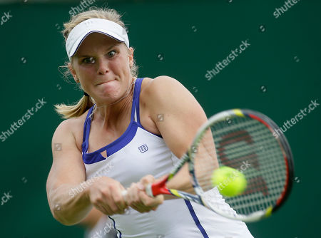 Melanie Oudin of the United States returns to Michelle Larcher De Brito of Portugal during their Women's first round singles match at the All England Lawn Tennis Championships in Wimbledon, London. Oudin was diagnosed with a muscle-damaging condition called rhabdomyolysis, a risk to both elite athletes and regular folks making a New Year's resolution to get fit