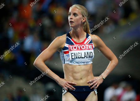 Britain's Hannah England reacts after placing fourth in the women's 1500-meter final at the World Athletics Championships in the Luzhniki stadium in Moscow, Russia