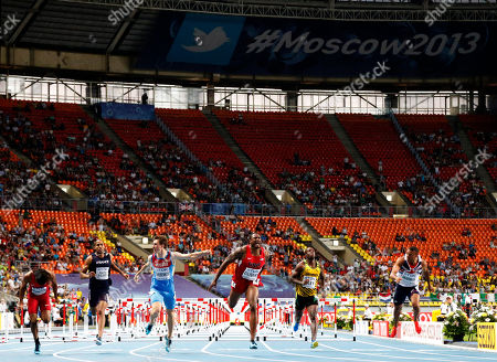 From left, United States' Jason Richardson, France's Thomas Martinot-Lagarde, Russia's Sergey Shubenkov, United States' David Oliver, Jamaica's Andrew Riley, and Britain's William Sharman cross the finish line in the men's 110-meter hurdles final at the World Athletics Championships in the Luzhniki stadium in Moscow, Russia, . Oliver won gold, Wilson silver and Shubenkov bronze