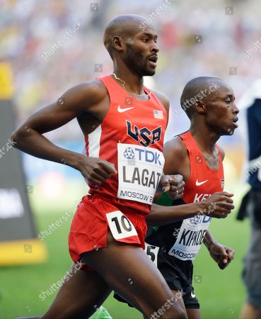 United States' Bernard Lagat, left, and Kenya's John Kipkoech compete in a men's 5000-meter heat at the World Athletics Championships in the Luzhniki stadium in Moscow, Russia