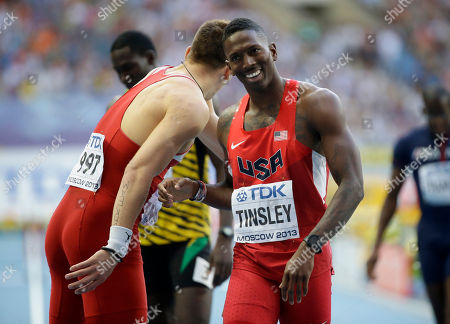 United States' Michael Tinsley, right, and Serbia's Emir Bekric congratulate each other after a men's 400-meter hurdles semifinal at the World Athletics Championships in the Luzhniki stadium in Moscow, Russia