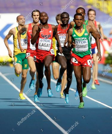 United States' Bernard Lagat, front left, and Ethiopia's Hagos Gebrhiwet, front right, compete in a men's 5000-meter heat at the World Athletics Championships in the Luzhniki stadium in Moscow, Russia