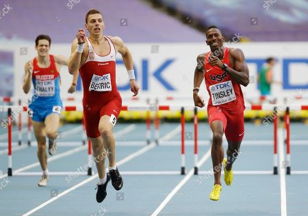 United States' Michael Tinsley, right, and Serbia's Emir Bekric compete in a men's 400-meter hurdles semifinal at the World Athletics Championships in the Luzhniki stadium in Moscow, Russia
