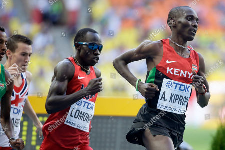 Kenya's Asbel Kiprop, right, leads United States' Lopez Lomong as they compete in a men's 1500-meter semifinal at the World Athletics Championships in the Luzhniki stadium in Moscow, Russia