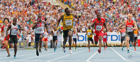 Jamaica's Usain Bolt, center, crosses the finish line ahead of United States' Justin Gatlin, second from right, Britain's Dwayne Chambers, second from left, Canada's Justyn Warner, left, and Germany's Martin Keller in the men's 4x100-meter relay final at the World Athletics Championships in the Luzhniki stadium in Moscow, Russia