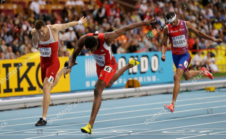 Serbia's Emir Bekric, Trinidad and Tobago's Jehue Gordon and Puerto Rico's Javier Culson cross the finish line in the men's 400-meter hurdles final at the World Athletics Championships in the Luzhniki stadium in Moscow, Russia