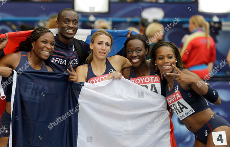 France's gold medal winner of the triple jump Teddy Tamgho, second left, poses with his gold medalist compatriots from the women's 4x-100-meter relay team, from left, Ayodele Ikuesan, Celine Distel-Bonnety, Stella Akakpo, and Myriam Soumare in the women's 4x100-meter relay team at the World Athletics Championships in the Luzhniki stadium in Moscow, Russia