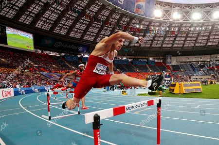 Serbia's Emir Bekric competes in the men's 400-meter hurdles final at the World Athletics Championships in the Luzhniki stadium in Moscow, Russia
