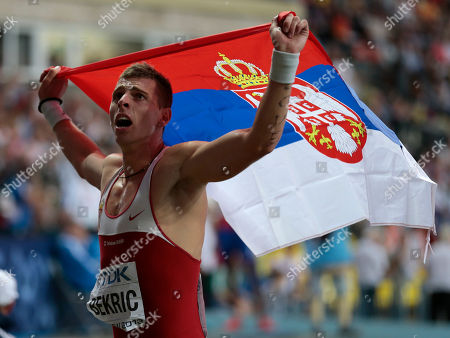 Serbia's Emir Bekric celebrates winning bronze in the men's 400-meter hurdles final at the World Athletics Championships in the Luzhniki stadium in Moscow, Russia