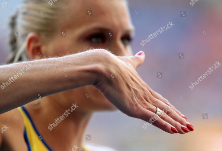 Sweden's Emma Green Tregaro prepares to competes in the women's high jump final at the World Athletics Championships in the Luzhniki stadium in Moscow, Russia, . The Swedish high jumper who sparked a controversy at the world championships by painting her fingernails in the colors of the rainbow to support gay rights took the field Saturday with a bright but politically neutral red instead. Tregaro had been told earlier that the rainbow motif could be a violation of the championships' code of conduct