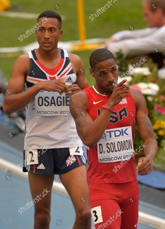 Britain's Andrew Osagie, left, and United States' Duane Solomon react after crossing the finish line in a men's 800-meter heat at the World Athletics Championships in the Luzhniki stadium in Moscow, Russia