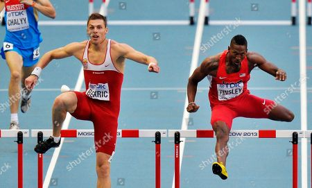 Serbia's Emir Bekric, left, and United States' Michael Tinsley compete in a men's 400-meter hurdles semifinal at the World Athletics Championships in the Luzhniki stadium in Moscow, Russia