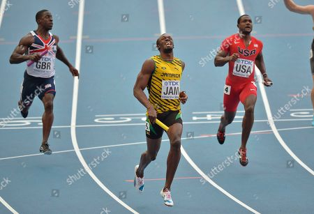 Jamaica's Usain Bolt, center, reacts after winning ahead of United States' Justin Gatlin, right, and Britain's Dwayne Chambers in the men's 4x100-meter relay final at the World Athletics Championships in the Luzhniki stadium in Moscow, Russia