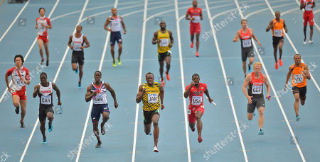 Stock Photo of Jamaica's Usain Bolt, center, United States' Justin Gatlin, third from right, and Britain's Dwayne Chambers, third from left, compete in the men's 4x100-meter relay final at the World Athletics Championships in the Luzhniki stadium in Moscow, Russia