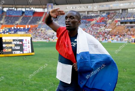 France's Teddy Tamgho celebrates winning the gold medal in the men's triple jump final at the World Athletics Championships in the Luzhniki stadium in Moscow, Russia