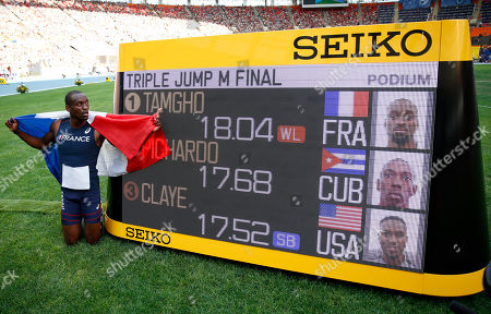 France's Teddy Tamgho poses next to the score board after winning the gold medal in the men's triple jump final at the World Athletics Championships in the Luzhniki stadium in Moscow, Russia