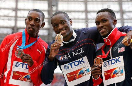 From left, Cuba's Pedro Pablo Pichardo, France's Teddy Tamgho and United States' Will Claye pose on the podium with their medals for the men's triple jump at the World Athletics Championships in the Luzhniki stadium in Moscow, Russia, . Tamgho won gold, Pichardo silver and Claye bronze