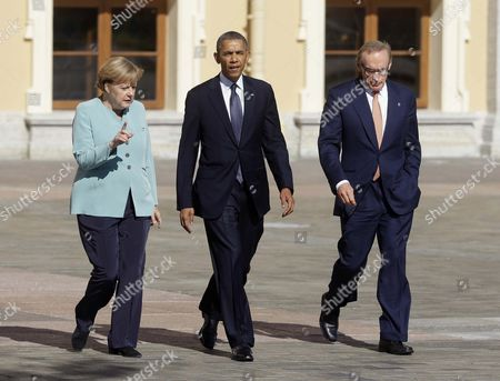 Barack Obama, Angela Merkel, Bob Carr U.S. President Barack Obama, center, walks with Germany's Chancellor Angela Merkel, left, and Australian Foreign Minister Bob Carr, right, prior to the group photo, at the G-20 summit at the Konstantin Palace in St. Petersburg, Russia