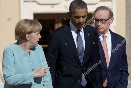 Stock Photo of Barack Obama, Angela Merkel, Bob Carr U.S. President Barack Obama, center, walks with Germany's Chancellor Angela Merkel, left, and Australian Foreign Minister Bob Carr prior to a group photo outside of the Konstantin Palace in St. Petersburg, Russia on . World leaders are discussing Syria's civil war at the summit but look no closer to agreeing on international military intervention to stop it