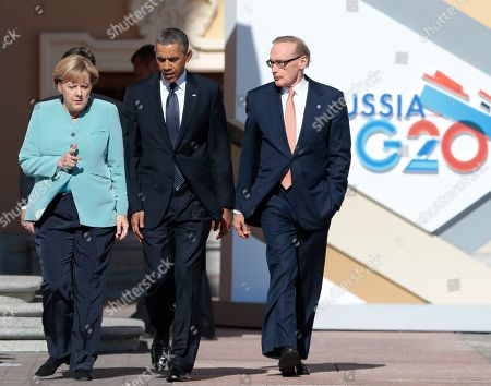 Angela Merkel, Barack Obama, Bob Carr U.S. President Barack Obama, center, walks with Germany's Chancellor Angela Merkel, left, and Australian Foreign Minister Bob Carr prior to a group photo of G-20 leaders outside of the Konstantin Palace in St. Petersburg, Russia on . World leaders are discussing Syria's civil war at the summit but look no closer to agreeing on international military intervention to stop it