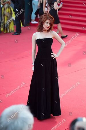 Anna Chapman Russian Anna Chapman, who was deported from the U.S. in July 2010 on charges of espionage, poses on the red carpet at the opening ceremony of the 35th Moscow International Film Festival in Moscow, Russia