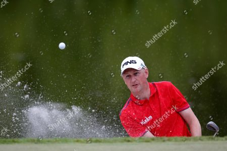 Simon Dyson Britain's Simon Dyson hits out of a bunker on the 18th hole during the third round at the M2M Russian Open golf tournament at Tseleevo Golf and Polo Club outside in Moscow, Russia