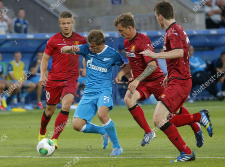 Andrey Arshavin, Martin Vingaard, Michael Jakobsen Zenit's Andrey Arshavin, second left, fights for the ball with FC Nordsjaelland's Martin Vingaard, left, and Michael Jakobsen, second right, during the second leg of the third qualifying round of the UEFA Champions League, between Nordsjaelland and Zenit St. Petersburg in St.Petersburg, Russia