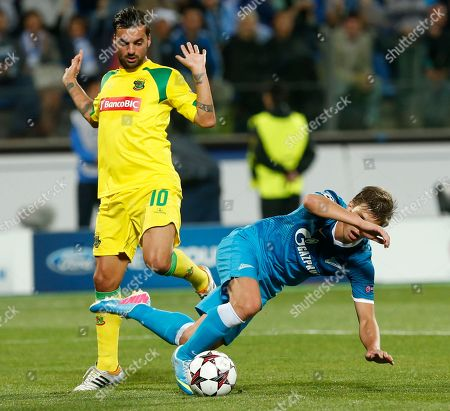 Andrey Arshavin, Rui Miguel Zenit's Andrey Arshavin, right, fights for the ball with Pacos Ferreira's Rui Miguel during the UEFA Champions League, play-off round, second leg soccer match, between Pacos Ferreira and Zenit St. Petersburg in St.Petersburg, Russia