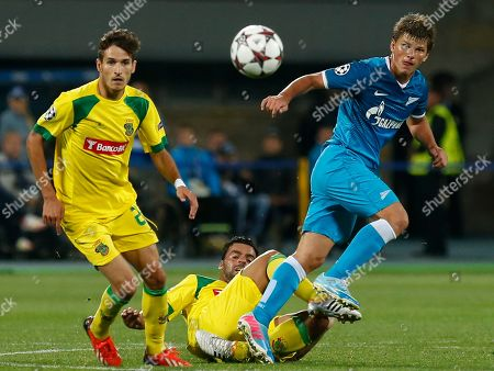 Andrey Arshavin, Helder Lopes, Rui Miguel Zenit's Andrey Arshavin, right, fights for the ball with Pacos Ferreira's Helder Lopes, left, and Rui Miguel, during their UEFA Champions League, play-off round, second leg soccer match, between Pacos Ferreira and Zenit St. Petersburg in St.Petersburg, Russia