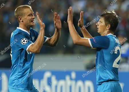 Andrey Arshavin, Igor Smolnikov Zenit's Andrey Arshavin, right, celebrates his goal against Pacos Ferreira with Igor Smolnikov during the UEFA Champions League, play-off round, second leg soccer match, between Pacos Ferreira and Zenit St. Petersburg in St.Petersburg, Russia