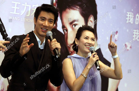 "Wang Leehom, Zhang Ziyi Chinese actor Wang Leehom, left, and Chinese actress Zhang Ziyi address the media during a press conference on at the Marina Bay Sands in Singapore ahead of the gala premiere of a Chinese-US romantic-comedy ""My Lucky Star"" directed by Dennie Gordon and co-produced by Chinese actress Zhang Ziyi"
