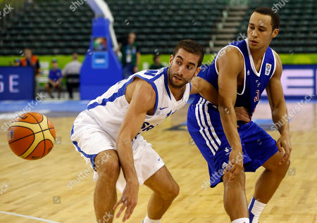 Yogev Ohayon, Andrew Lawrence Israel's Yogev Ohayon, left, challenges for the ball with Britain's Andrew Lawrence during their EuroBasket European Basketball Championship Group A match in Ljubljana, Slovenia