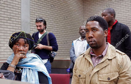 Makaziwe Mandela, daughter of former South African president Nelson Mandela, left, and grandson Ndaba Mandela, right, sit in court in Mthatha, South Africa, . As Nelson Mandela remains hospitalized in critical condition, the 94-year-old's oldest daughter, Makaziwe, and 15 other family members have pressed a court application to get Mandela's grandson, Mandla Mandela, to return the bodies of three of Mandela's children to their original graves in the eastern rural village of Qunu