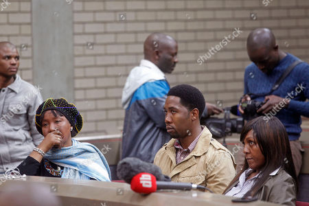 Makaziwe Mandela, daughter of former South African president Nelson Mandela, left, grandson Ndaba Mandela, center, and granddaughter Ndileka Mandela, right, sit in court in Mthatha, South Africa, . As Nelson Mandela remains hospitalized in critical condition, the 94-year-old's oldest daughter, Makaziwe, and 15 other family members have pressed a court application to get Mandela's grandson, Mandla Mandela, to return the bodies of three of Mandela's children to their original graves in the eastern rural village of Qunu