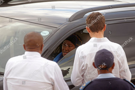 Makaziwe Mandela, center, daughter of former South African president Nelson Mandela, arrive at Mandla Mandela, grandson of Mandela, home to collect remains in Mvezo, South Africa, . A South African court ruled Wednesday that Nelson Mandela's grandson must return the bodies of the former president's three deceased children to their original burial site. The court ruled against grandson Mandla Mandela, who moved the bodies of three Mandela children in 2011 from Mandela's hometown in Qunu to his birthplace of Mvezo, about 25 kilometers (15 miles) away