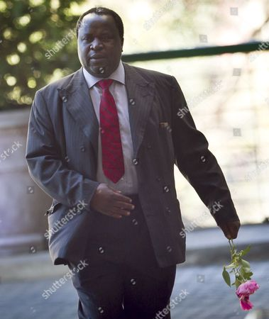 Tito Mboweni Former Governor of the South African Reserve Bank, Tito Mboweni, carries flowers as he arrives at the Mediclinic Heart Hospital where former South African President Nelson Mandela is being treated in Pretoria, South Africa . Mandela remains in critical condition