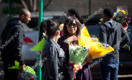 Ndileka Mandela Granddaughter Ndileka Mandela, center, gestures as she and other family relatives carry bunches of flowers that were left by wellwishers into the Mediclinic Heart Hospital where former South African President Nelson Mandela is being treated in Pretoria, South Africa . President Jacob Zuma canceled a trip to Mozambique on Thursday in an indication of heightened concern about Mandela, whose health deteriorated last weekend