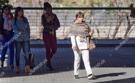 Tukwini Mandela, Ndileka Mandela, Makaziwe Mandela Granddaughter Tukwini Mandela, left, granddaughter Ndileka Mandela, second left, and daughter Makaziwe Mandela, right, arrive at the Mediclinic Heart Hospital where former South African President Nelson Mandela is being treated in Pretoria, South Africa . One of the former president's daughters said he is still opening his eyes and reacting to the touch of his family even though his situation is precarious. Woman at second right is unidentified