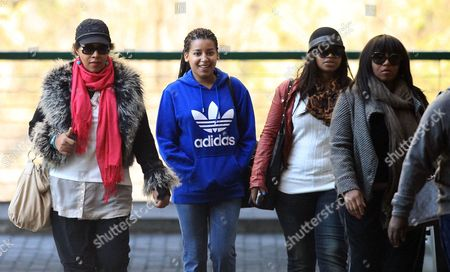 Stock Image of Zenani, Dlamini-Mandela Daughter Zenani Dlamini-Mandela, left, with granddaughters Swati Dlamini, second right, and Zaziwe Dlamini-Manaway, right, and an unidentified family member arrive at the Mediclinic Heart Hospital where former South African President Nelson Mandela is being treated in Pretoria, South Africa . Mandela remains in the hospital for a ninth day. The 94-year-old was hospitalized for a recurring lung infection