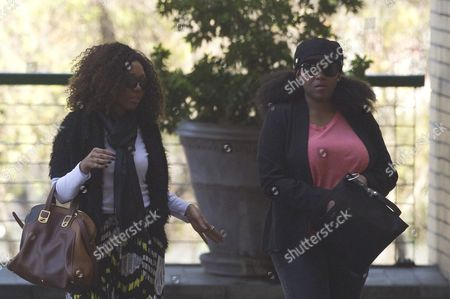 Stock Photo of Nelson Mandela Granddaughters Swati Dlamini, left, and Zaziwe Dlamini-ManawayZaziwe Dlamini-Manaway, right, arrive at the Mediclinic Heart Hospital where former South African President Nelson Mandela is being treated in Pretoria, South Africa