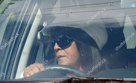 """Nelson Mandela Granddaughter Ndileka Mandela leaves the Mediclinic Heart Hospital where former South African President Nelson Mandela is being treated in Pretoria, South Africa, . Mandela will spend his 95th birthday in hospital Thursday, but was said to be making """"remarkable"""" progress"""