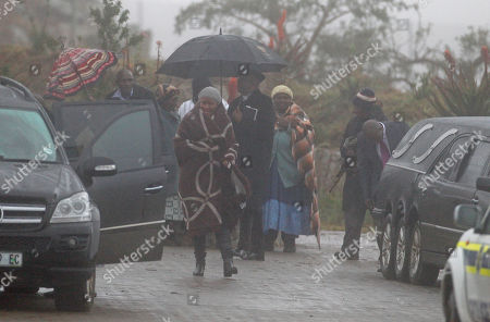 Makaziwe Mandela, center, daughter of former President Nelson Mandela walks to a car after a funeral at Nelson Mandela's house in Qunu, South Africa, . In a macabre family feud fought as Nelson Mandela remained in critical condition, a South African court ruled Wednesday that the former president's grandson must return the bodies of the 94-year-old's three deceased children to their original burial site